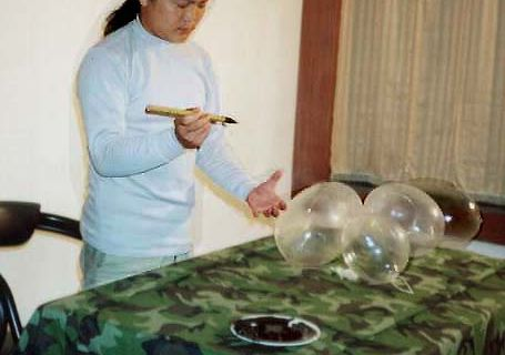 The burst-that is caused by the chemical reaction of writing 'recluse' on a condom with printing ink @ Qing Yang. 2000. 1st open fest. Pékin. Chine
