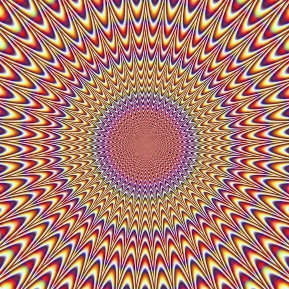 des cercles concentriques parcourus par des rayons de couleurs irisées