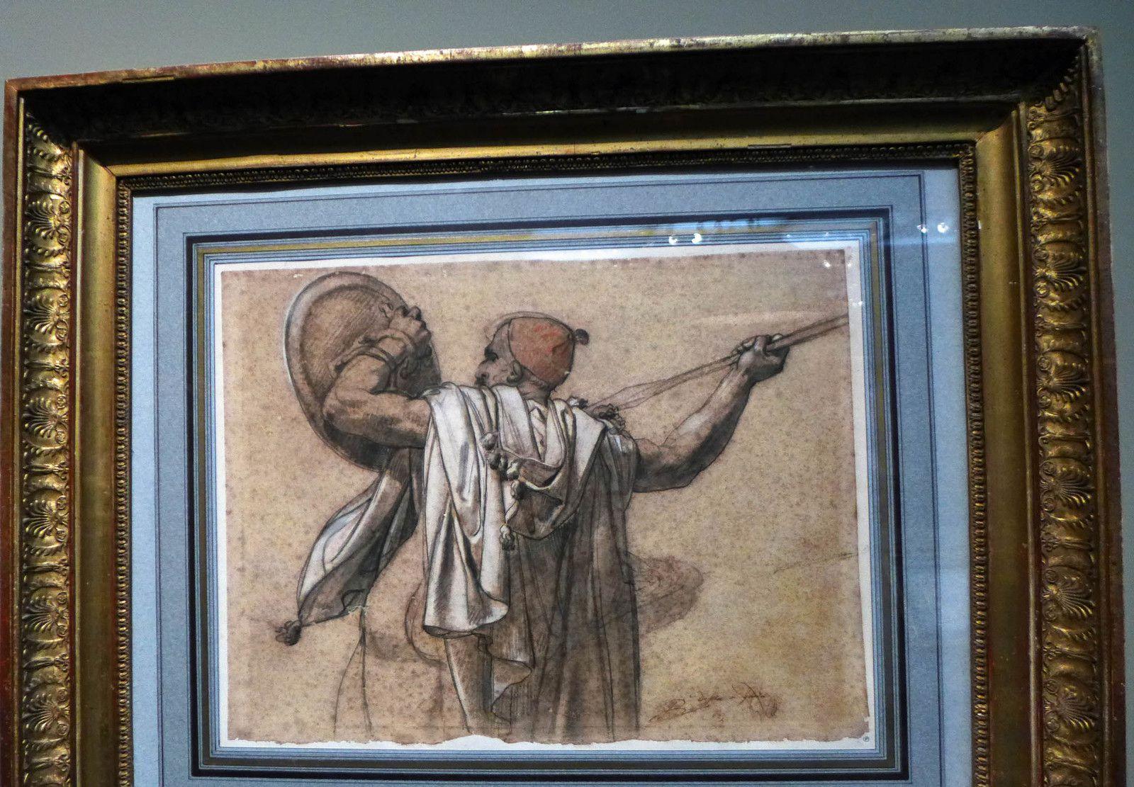 AnneLouis GIRODET, Turc vu de dos, tourné vers la gauche, levant sa lance et son bouclier (Pierre noire, fusain, estompe, rehauts de craie blanche et de pastel sur papier beige).
