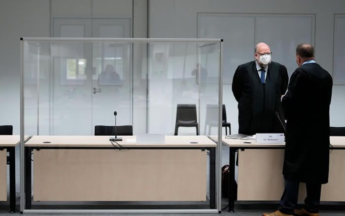 German lawmakers stand next to an empty seat of the accused at the courtroom, prior to a trial against a 96-year-old former secretary for the SS commander of the Stutthof concentration camp in Poland Credit: Shutterstock