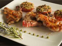 Côtes d'agneau et tomates provençales
