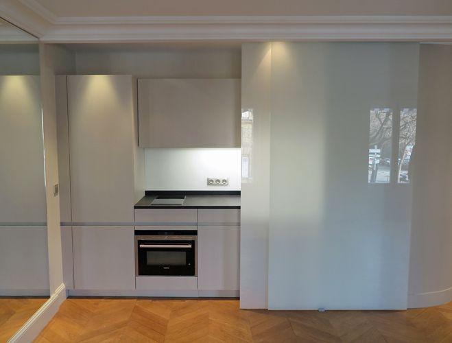 Restructuration d'un appartement paris 17 eme. Ouverture de mur porteur et modification des espaces cuisine salle de bains et coin nuit.