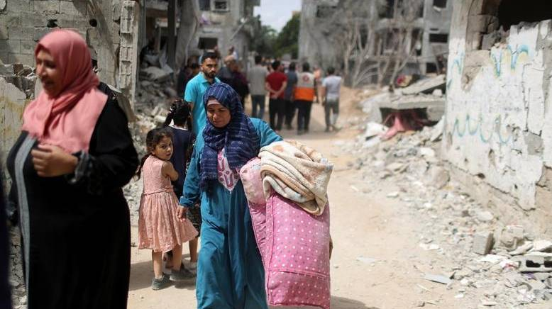 Humanitarian convoys arrive as Gazans take stock of the damage from 11 days of intense fighting.