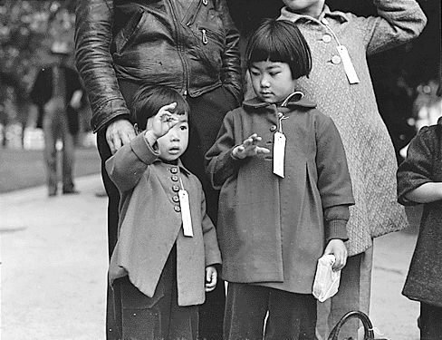 """Dorothea Lange """"Colored family from Houston (Texas) in California"""" (1939), """"Japanese children with tags"""" (1942)"""