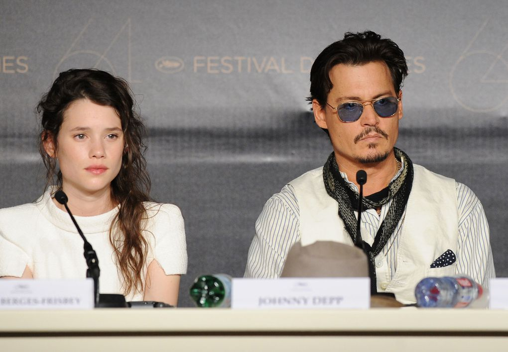 "Johnny Depp and Penelope Cruzattends the ""Pirates of the Caribbean: On Stranger Tides"" press conference at the Palais des Festivals during the 64th Cannes Film Festiva lon May 14, 2011 in Cannes, France."