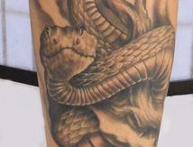Tatouage Serpent Mollet