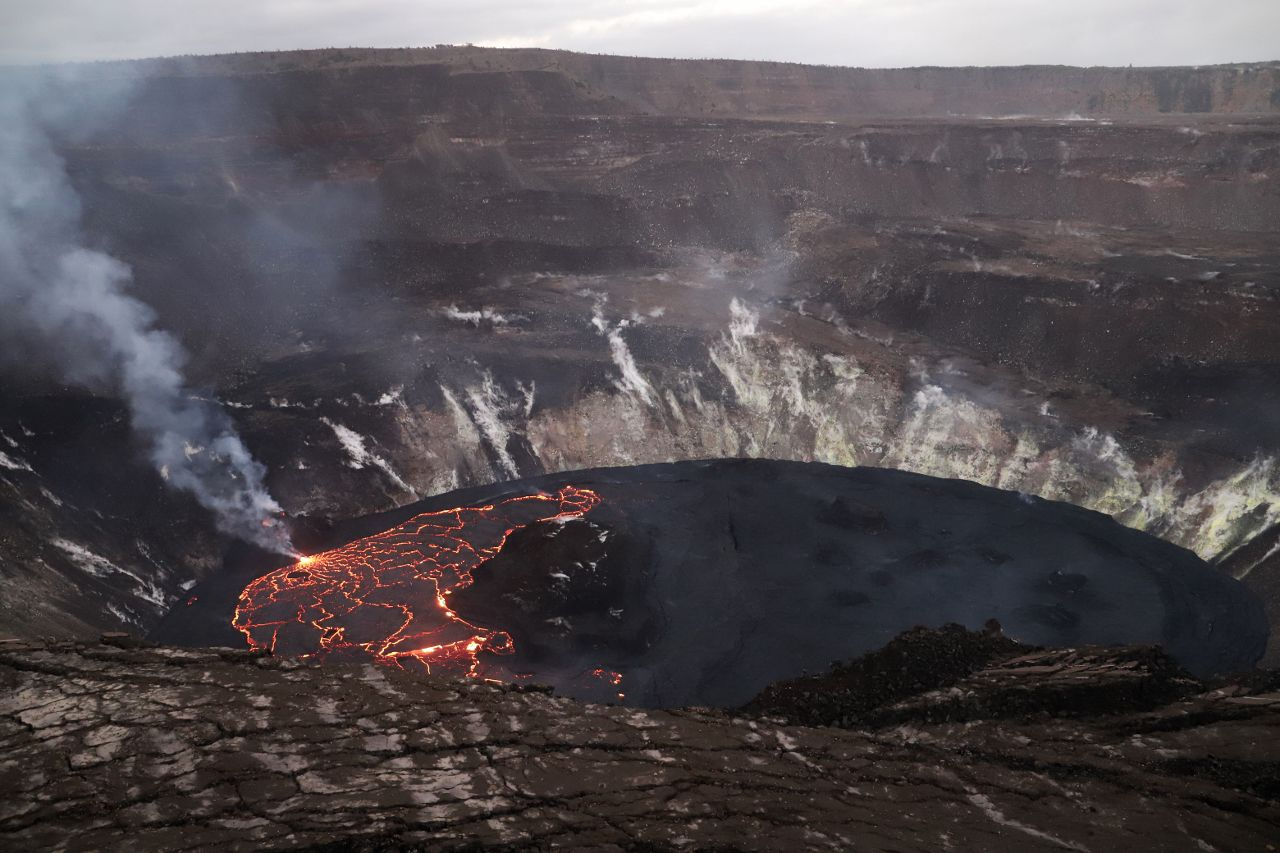 Kilauea - Halema'uma'u - active western (left) part of the lava lake, which has hot glowing lava visible at the boundaries between the plates on the lava lake. The inactive eastern (right) part of the lake looks dark. USGS photo taken by N. Deligne on February 10, 2021.
