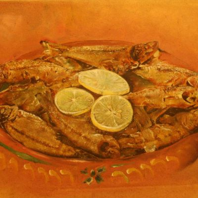 Delicious Fried Fish On A Pan Of Sizzling Curry Garnished With Lemon Slices
